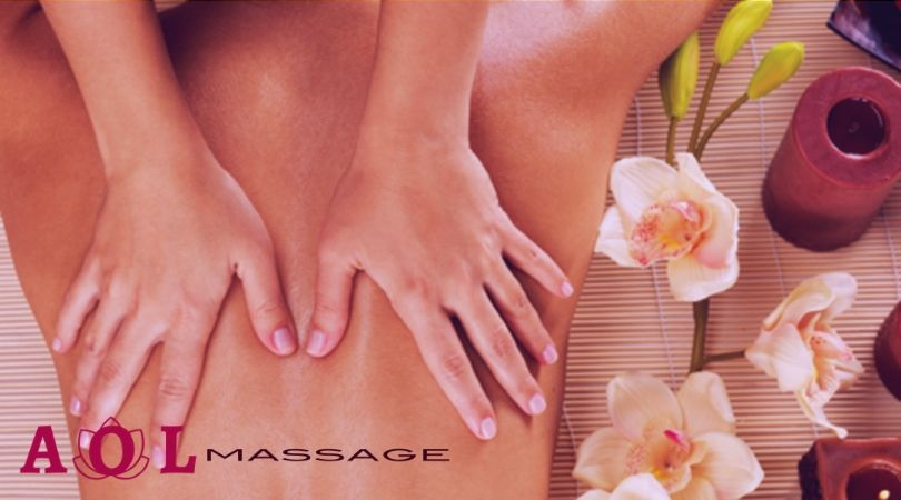 hands on a back - best massage in spa chicago