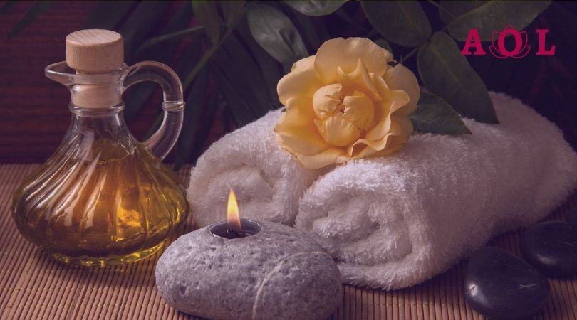 towel, flower, a candle on stone and olive oil, relaxing resources