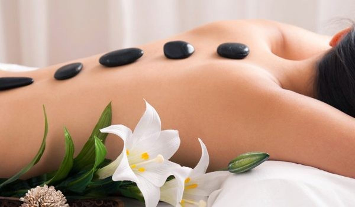 woman getting a stone massage in her back