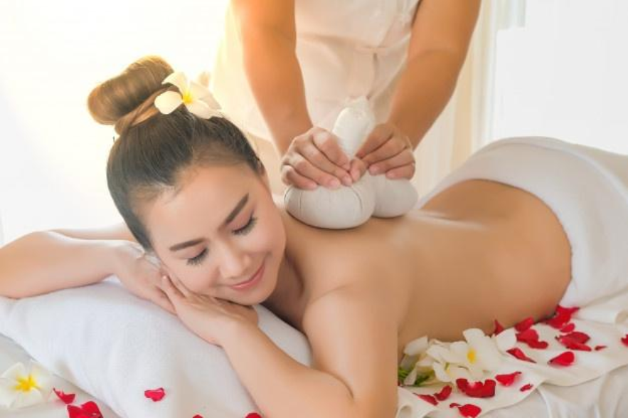 woman getting a professional massage with cups in the back