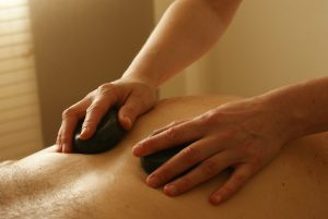 How Hot Stone Massages Can Melt Away the Winter Blues